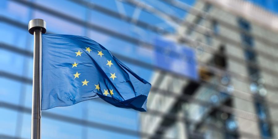 EU flag behind European parliament